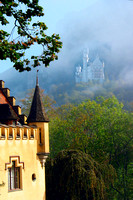 Viewing Castle Neuschwanstein through fog at Hohenschwangau, Germany